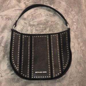 Used once … Michael Kors Brooklyn black with silver grommets purse
